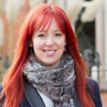 Anna Hart web copywriting client white woman with long red hair smiles at camera