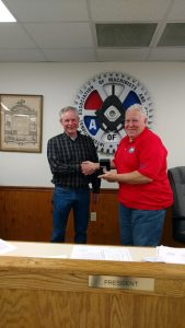 Dennis Connolly receiving his retirement watch.