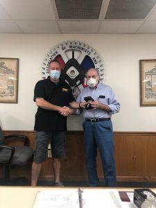 Richard Kunkel receives a retirement watch from President Howard Ferguson