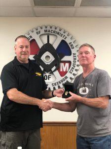 Paul Striebich receives a retirement watch from President Howard Ferguson