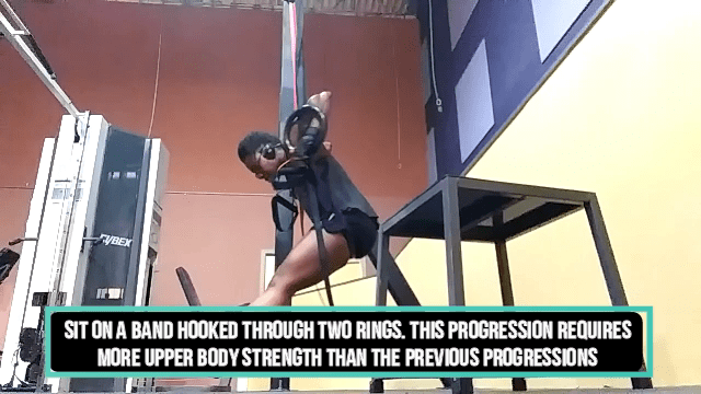 Woman doing ring muscle-up progressions