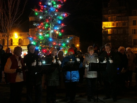 Handbell ringers at carols around the tree
