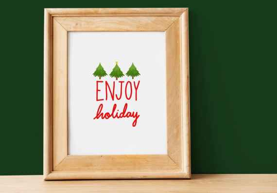 framed signage of enjoy holiday text