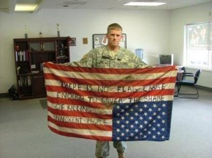OWS Soldier with upside down flag about the shame of killing innocent people