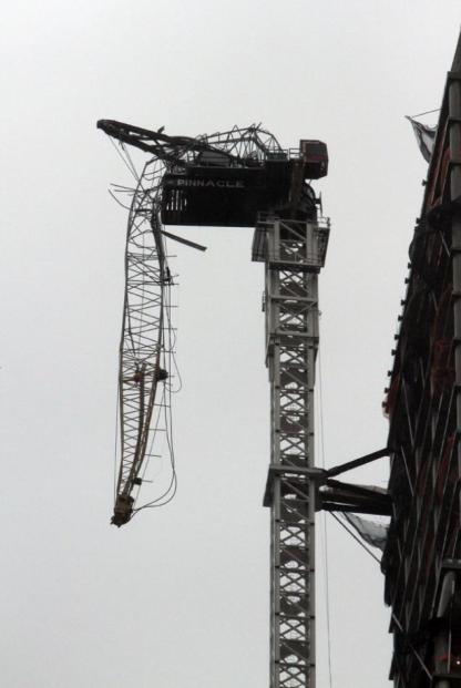Crane crumbled from winds in Manhattan. Crane is at the top of a new luxury high rise being built.