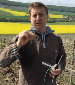 Franck Pascal with antenna in his bioenergetically-farmed Champagne vineyards. ©CarolineHenry 2016.