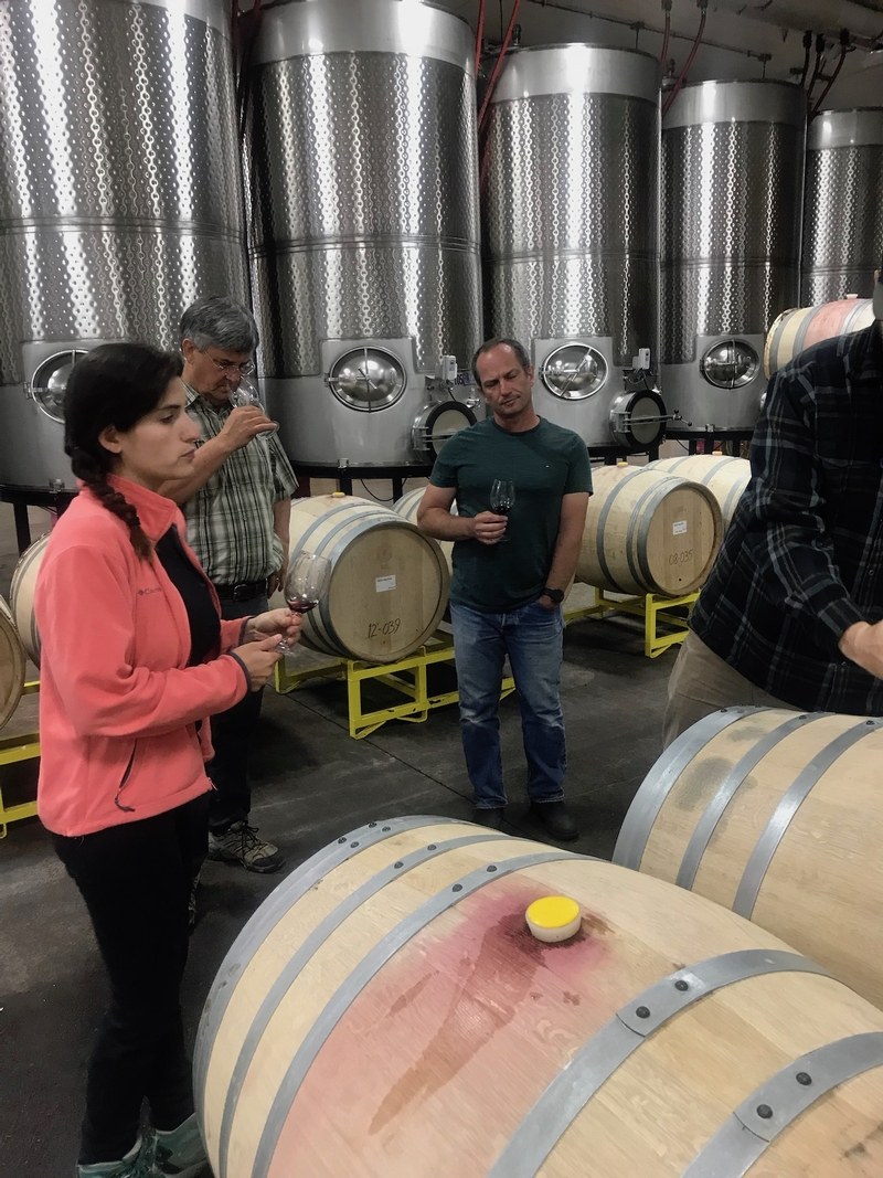 Iris Vineyards winemaking team tastes through base wine samples at their winery in Eugene, Oregon.