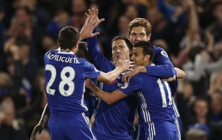 Eden Hazard celebrates with teammates after putting Chelsea ahead. Image from: Reuters
