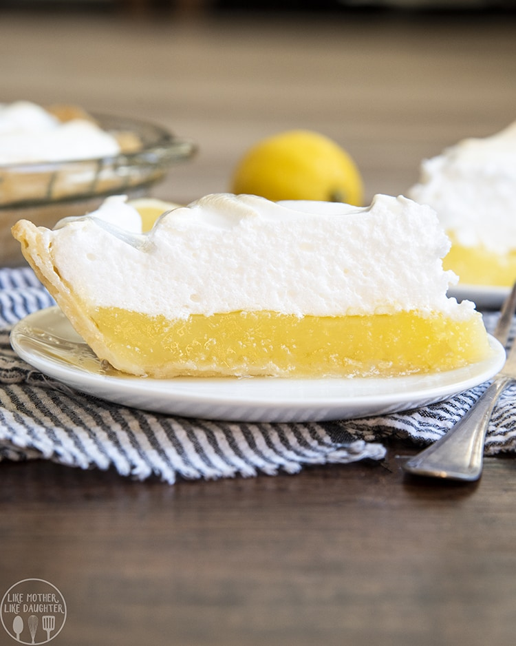 A perfect slice of lemon meringue pie with the best thick meringue topping