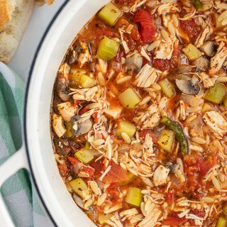A pot of Italian Turkey Orzo Soup loaded with lots of vegetables.