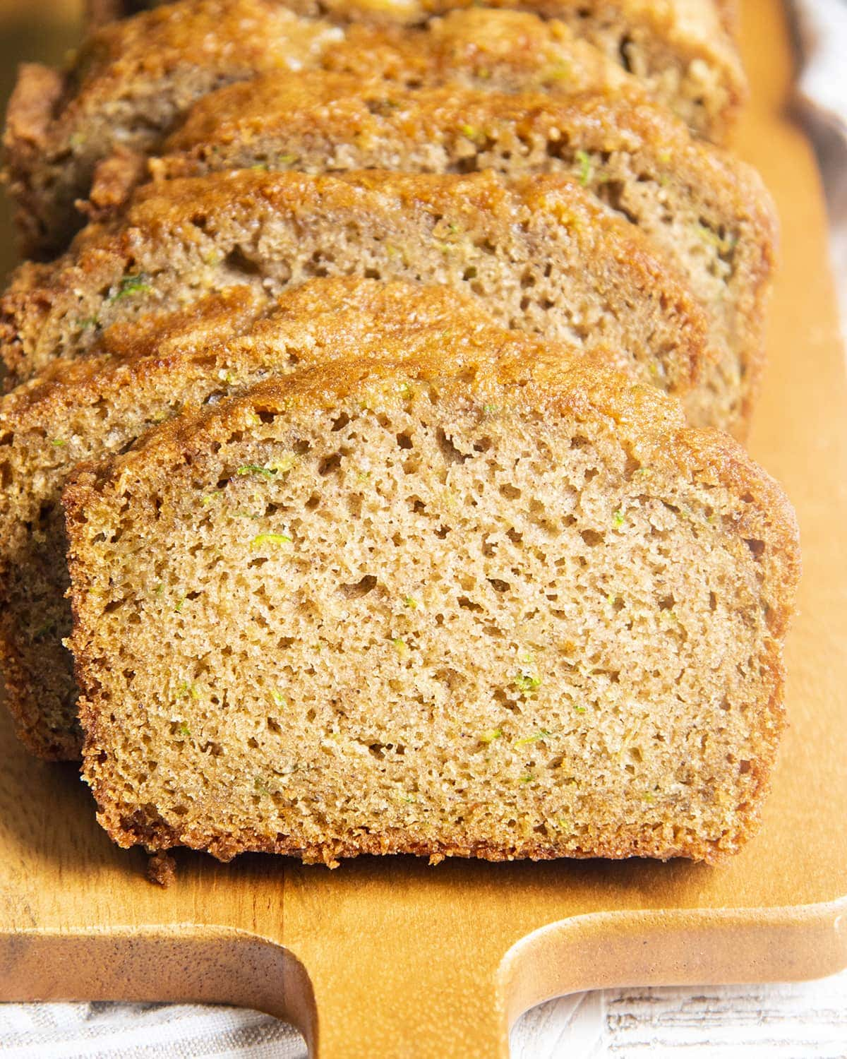 Slices of zucchini bread leaning on one another.
