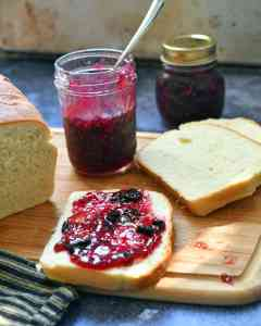 A small batch of fresh fruit jam made with sweet raspberries, plump blueberries, and a smidgen of orange zest and chopped orange for your own homemade raspberry blueberry jam.