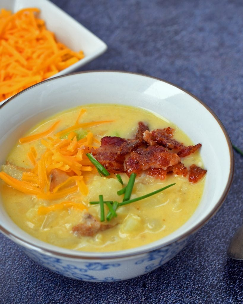 A potato lover's soup! This cheesy baked potato soup is stocked full of flavor from onions, garlic, broth - vegetable or chicken, cheese, and lots and lots of potatoes.