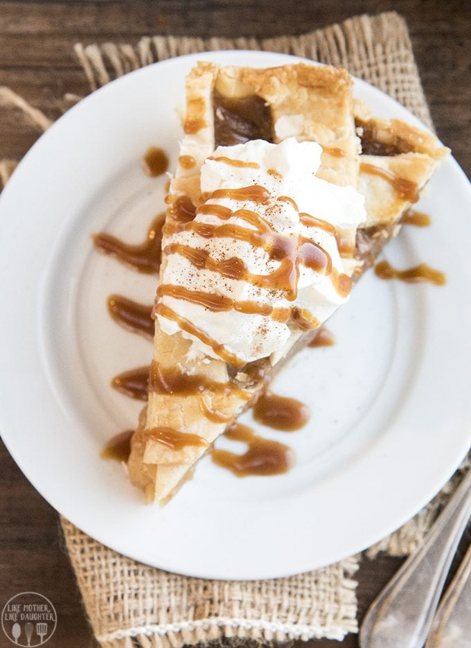Caramel apple pie is such a fun twist on traditional apple pie! The apples are covered in a cinnamon caramel goodness to make this the best apple pie ever.