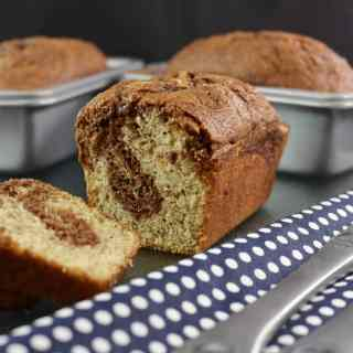 Nutella is swirled right into this moist and luscious Nutella Swirled Banana Bread for an amazing flavor merger of banana and chocolate hazelnut.