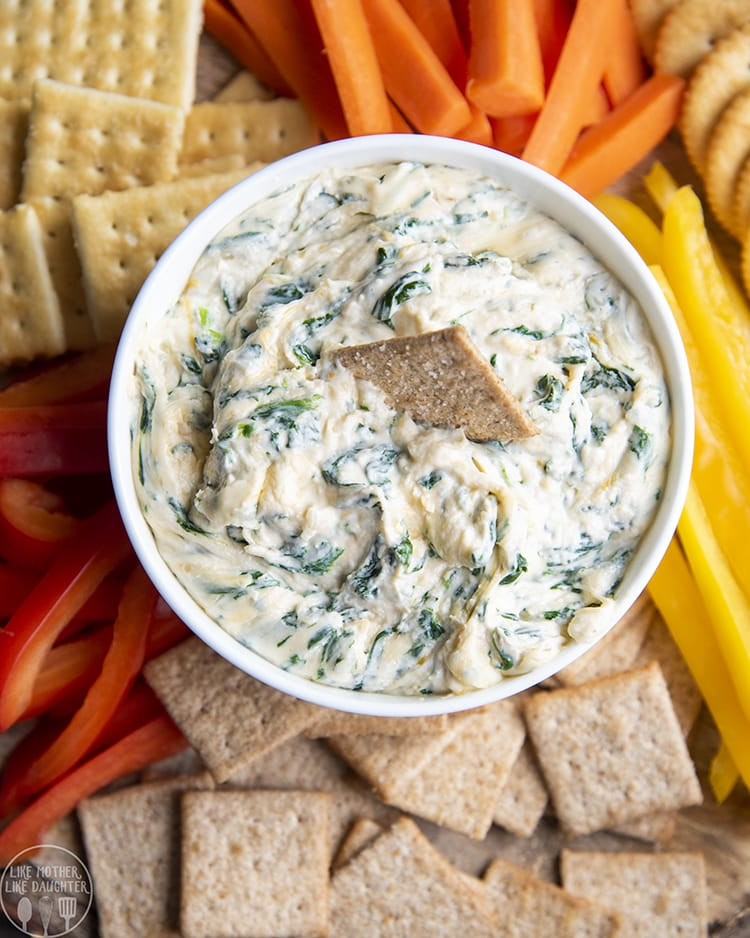 Spinach dip is perfect served with crackers for a holiday party