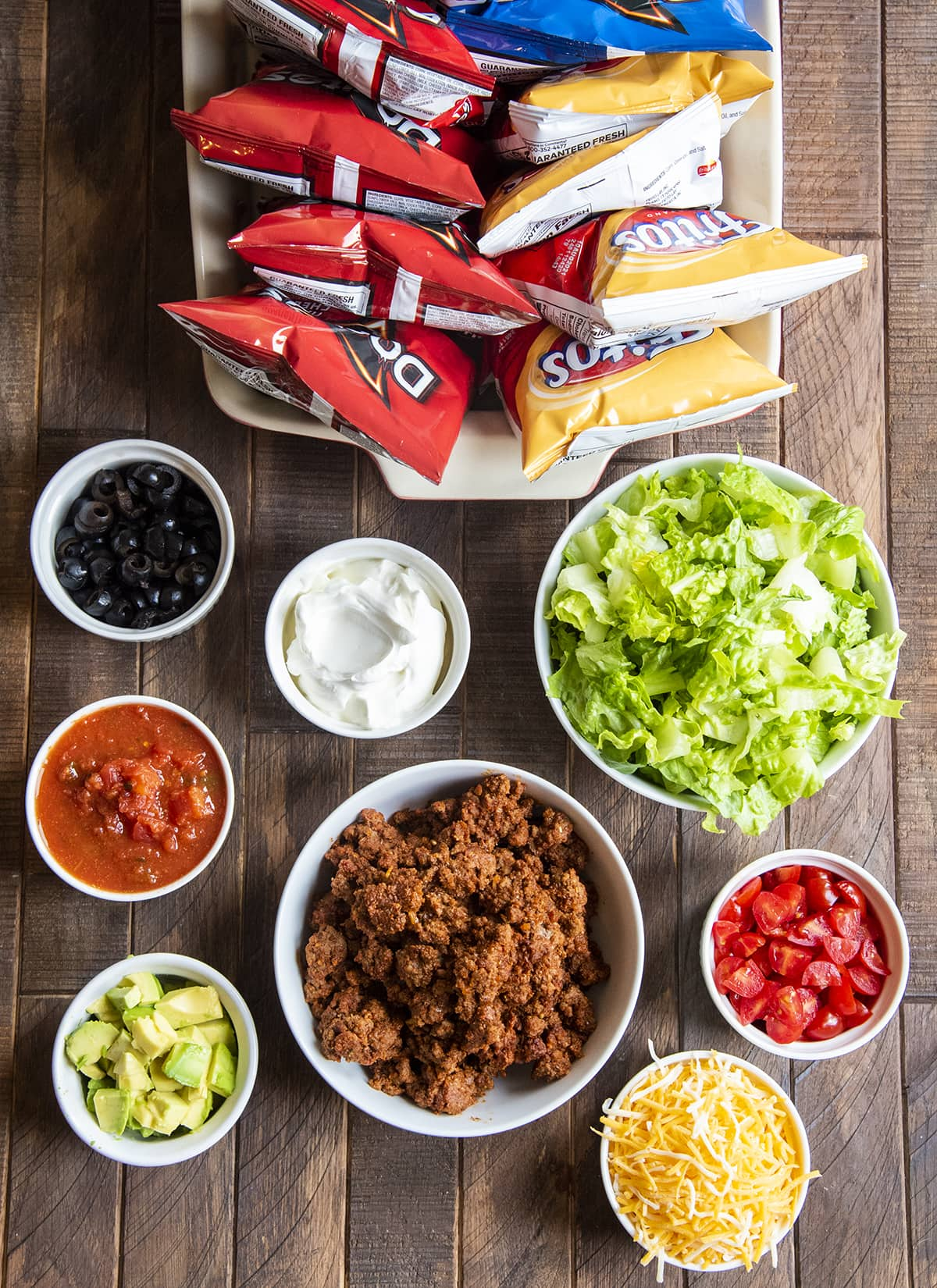 An overhead shot of the ingredients needed to make walking tacos.