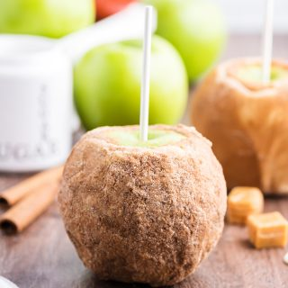 An apple pie caramel apple on a stick.
