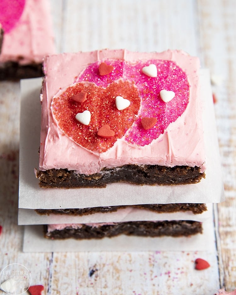 Brownies topped with pink frosting and heart sprinkles are perfect for Valentine's Day