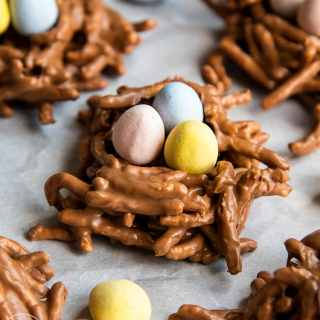 Birds nests made from chow mein noodles coated in chocolate and stuffed with three candy eggs.