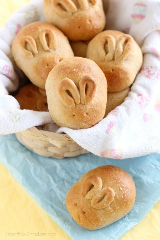 Rolls in a basket that are cut and shaped to look like they have little bunny ears.