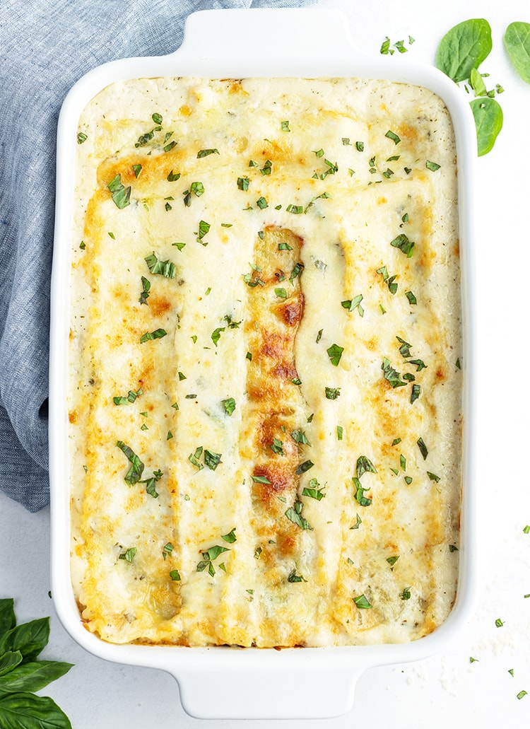 A pan of white chocolate lasagna topped with parsley