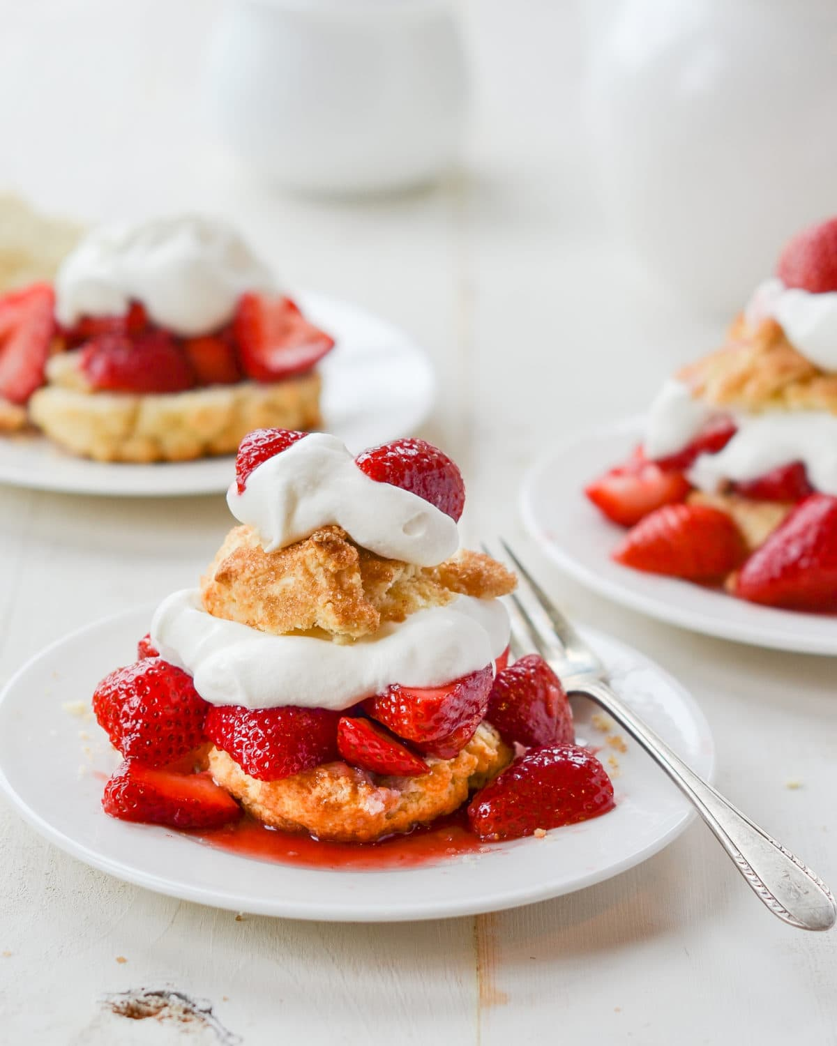 Strawberry Shortcake layered with biscuit, strawberries, and cream on a plate