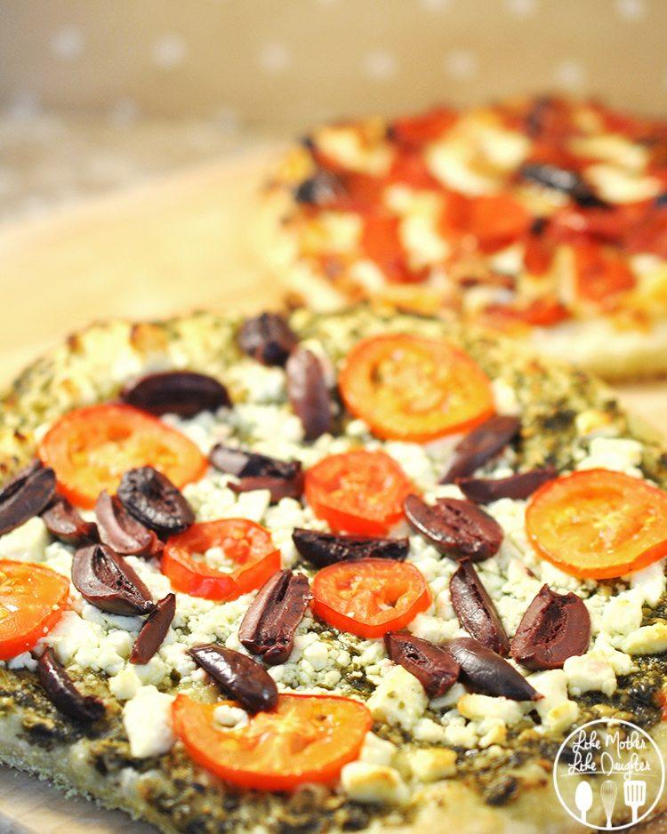 Mediterranean Mini Pizzas - Great mini pizzas topped with pesto, feta, olives and tomatoes!