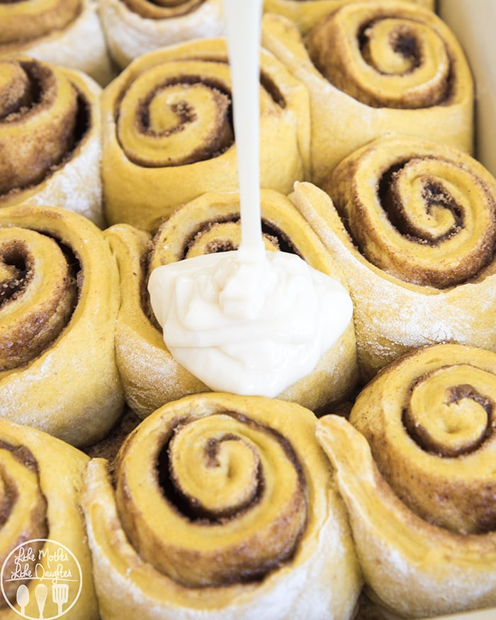 Pumpkin Cinnamon Rolls topped with a tangy cream cheese frosting