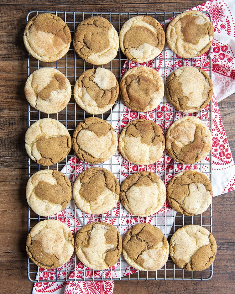 A cooling rack with gingerdoodle cookies set across 4x5. The cookies are half ginger molasses, half snickerdoodle cookie swirled together.