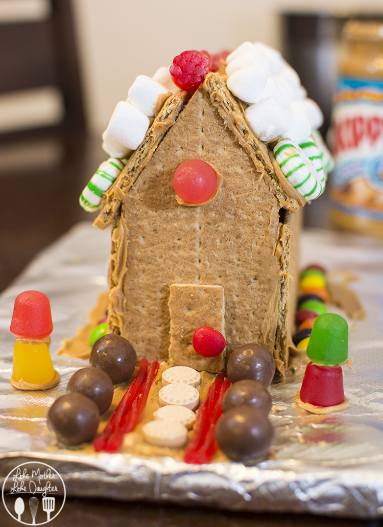 Have you ever tried making graham cracker houses with peanut butter? Its easy, cute and totally edible. Yum!