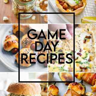 "A collage of game day recipes with a text overlay that says ""Game Day Recipes"" there is cowboy caviar, a philly cheesteak slider, a ranch popcorn mix, taco cups, pigs in a blanket, cheesy bacon dip, a pulled pork sandwich, jalapeno covered in cheese and wrapped in bacon, green salsa, and chex mix."
