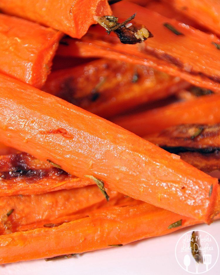 Roasted Carrots - These easy roasted carrots are seasoned with salt, rosemary and thyme for a delicious side dish, snack or perfect in soup.