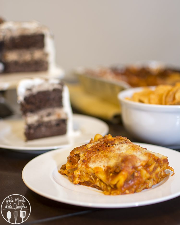 Touchdown Butterfinger Cup Ice Cream Cake - this delicious and easy ice cream cake is time consuming, but totally worth the wait for a chocolate cake covered in vanilla ice cream, butterfinger cups, caramel chocolate candies and coolwhip!