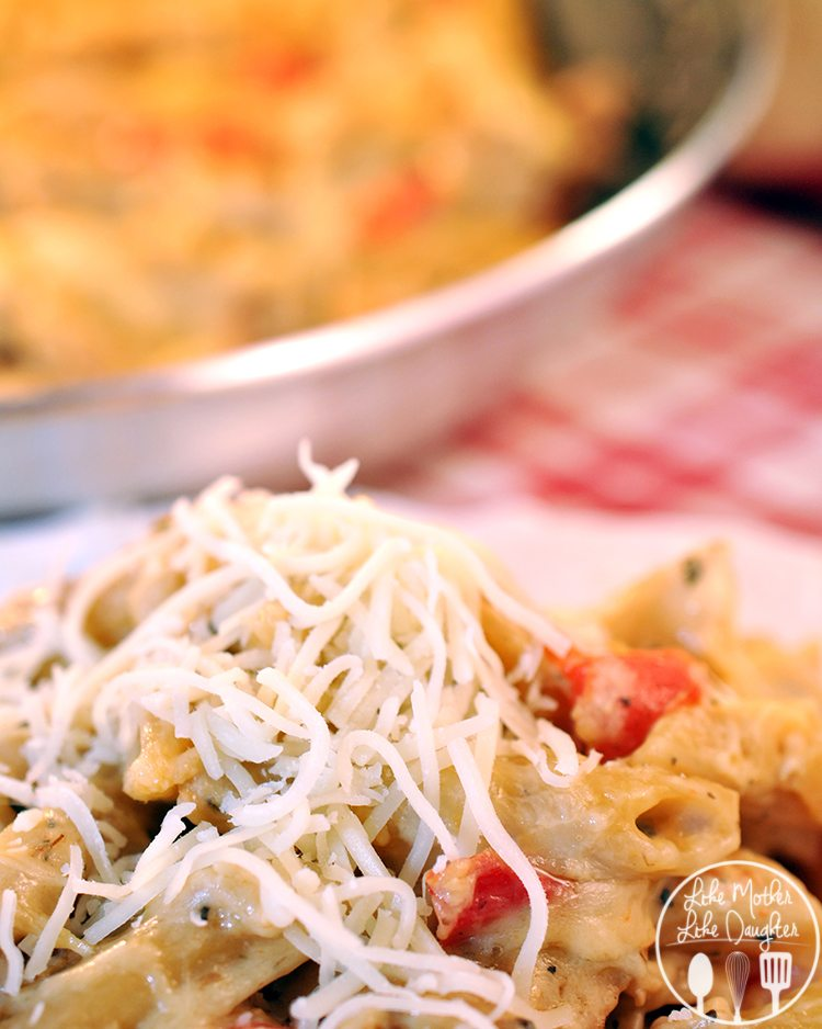 One pan cheesy chicken and penne uses Sargento shredded Chef Blend 6 Italian cheeses for amazing cheesy flavor, along with chicken, Greek yogurt, red peppers, and other flavorful ingredients for an easy, delicious one pan meal.