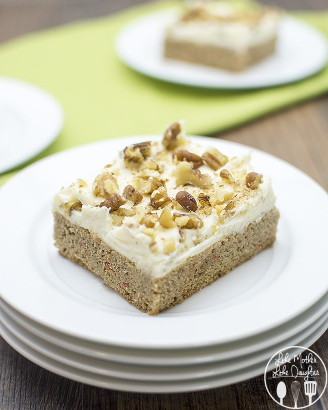 carrot cake cookie bars - these delicious and easy to make cookie bars start with a cake mix, for a spiced carrot cake topped with creamy cream cheese frosting and crunchy nuts.