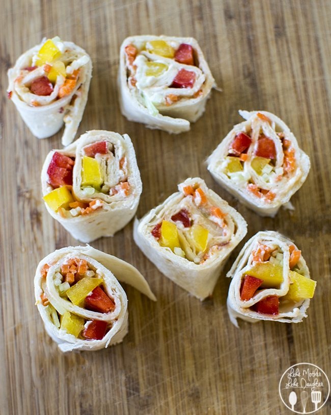 Sweet Chili Veggie Roll Ups - These lower calorie sweet chili veggie roll ups are the perfect snack. They're made with a homemade sweet chili sauce, all rolled up in a tortilla with fat free cream cheese and julienned vegetables