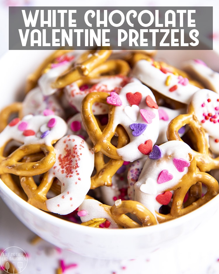 These Valentine pretzels are a delicious white chocolate dipped pretzel, topped with red, and pink, and heart sprinkles for a perfect Valentine's Day Treat!