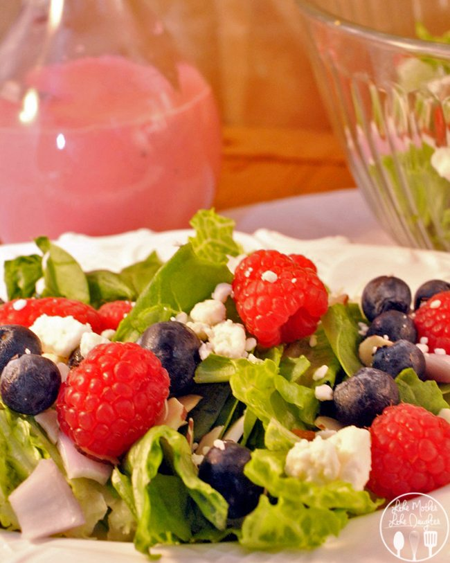 Red, White, and Blue Garden Salad - this salad is a delightful, patriotic, proud of my country garden salad with fresh raspberries, blueberries, goat cheese drizzled with raspberry vinaigrette.