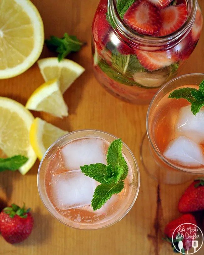 Strawberry Grapefruit Mint Infused Water - this is a refreshing way to enjoy your daily water. Water, strawberries, grapefruit, and mint leaves - healthy and flavorful!
