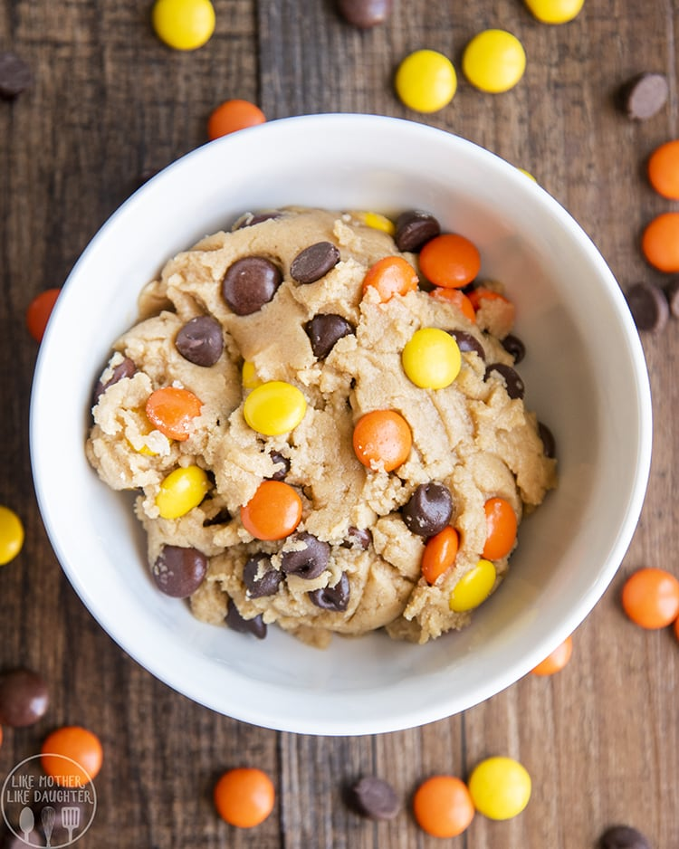 A bowl for one of edible peanut butter cookie dough with reeses pieces and chocolate chips