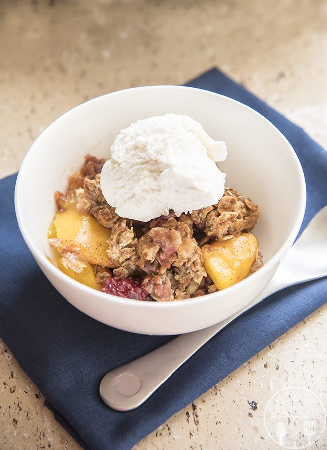 Blackberry Peach Crisp - This delicious blackberry and peach crisp is free of refined sugars and perfect for a lighter dessert. The sweet fruit is covered in an amazing honey, oat and pecan crumble that you'll just love!