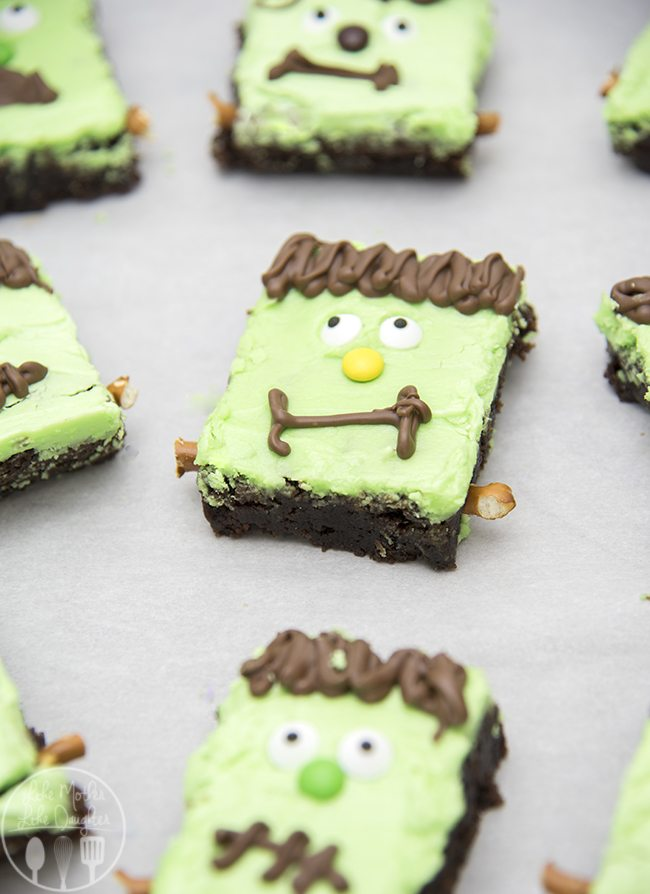 Frankenstein Monster Brownies - These adorable monster brownies are topped with a mint frosting, chocolate and candy eyes for an easy Halloween dessert.