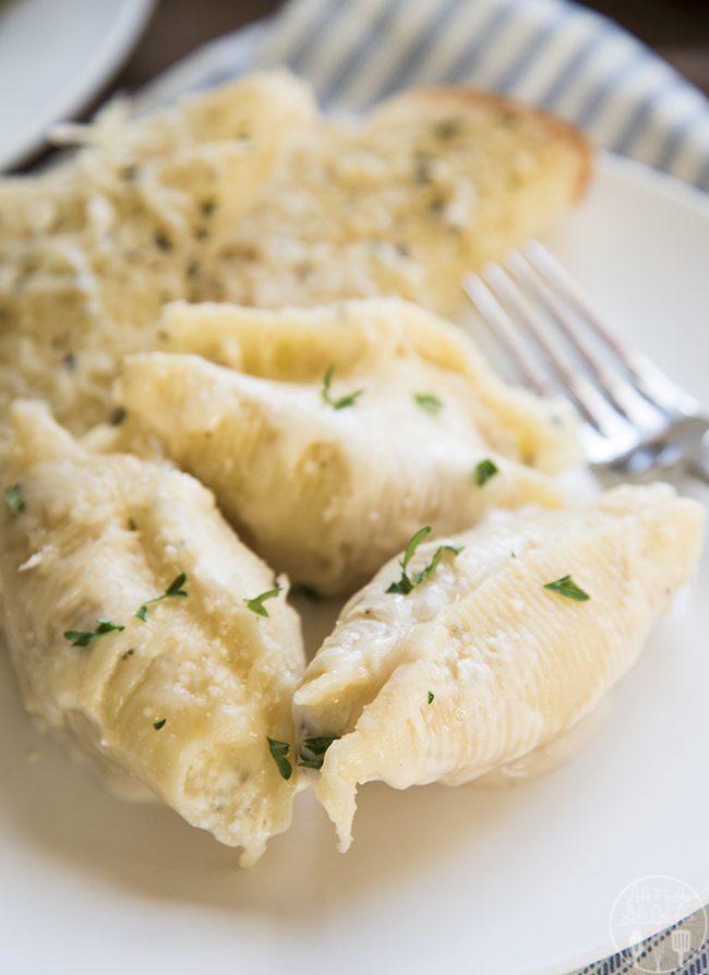 Chicken stuffed shells with alfredo sauce