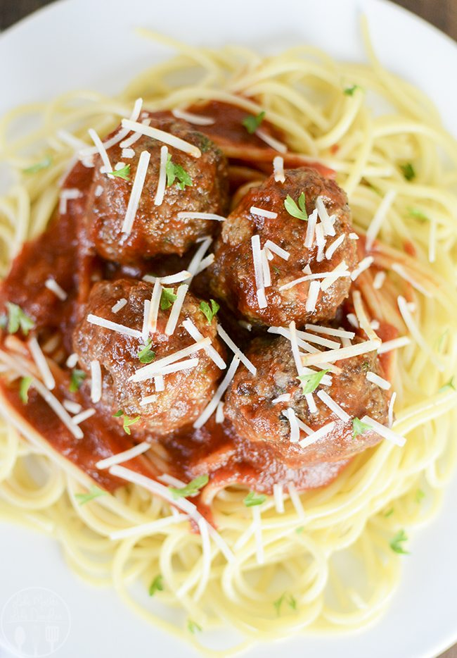 Italian Meatballs - These delicious Italian meatballs are packed full of flavor and easy to make. Perfect served on top of a bed of spaghetti and marinara!