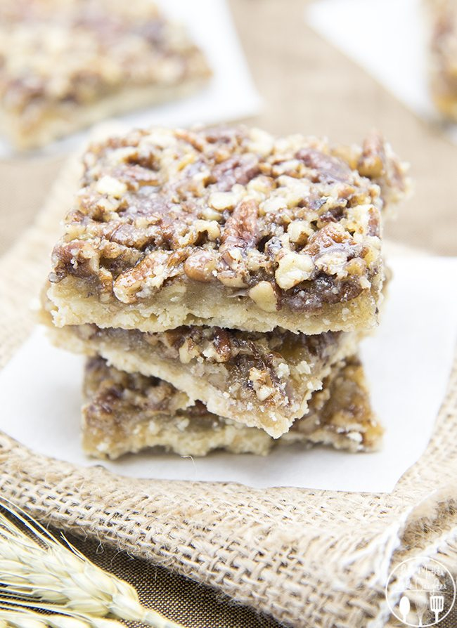 Pecan Pie Bars - With a crumbly buttery crust and a sugary sweet pecan pie topping these bars have the same great taste of pecan pie in bar form!