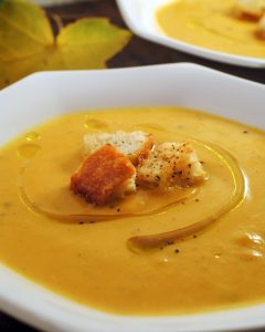 Autumn soup combines acorn and butternut squash with pumpkin, apples, onions, and sage. The perfect rendering of fall in a soup.