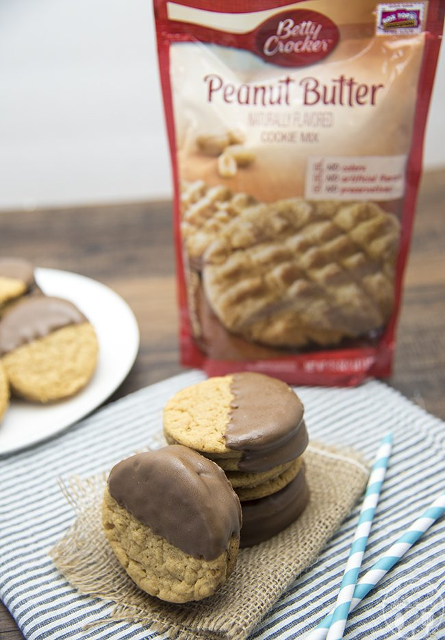 Chocolate Dipped Peanut Butter Sandwich Cookies - These delicious peanut butter sandwich cookies, have a soft peanut butter cookie with a creamy peanut butter frosting, all dipped in chocolate for that perfect peanut butter chocolate combo!