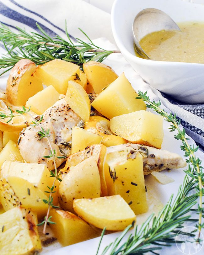 Herb Roasted Chicken and Potatoes - A simply roasted chicken with potatoes and lemon slices with a fresh herb sauce. All with easy preparation and elegant presentation.