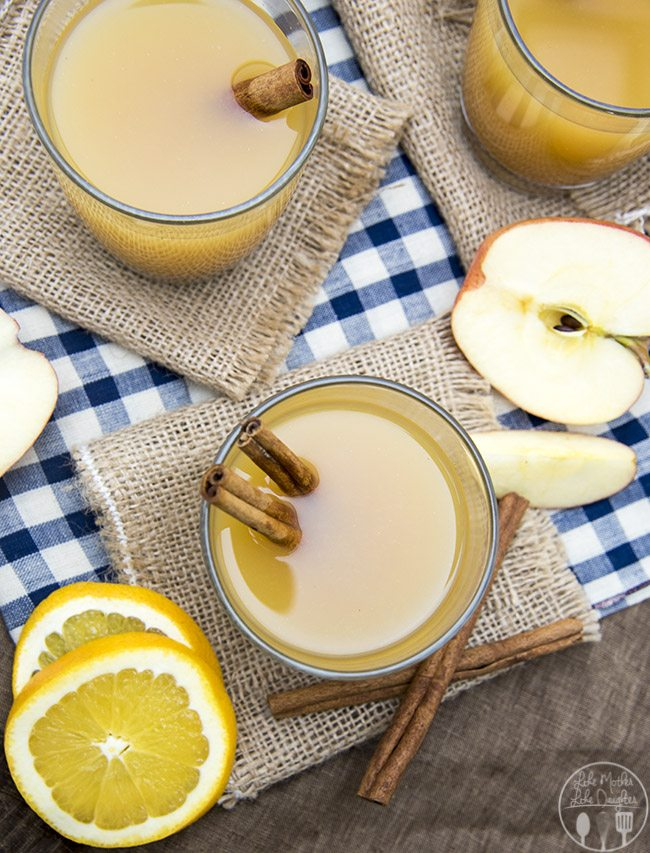 This Hot wassail drink combines apple cider, pineapple juice and orange juice with a great cinnamon undertone for a perfect holiday drink! It can be made on the stove or in a slow cooker!